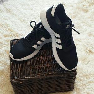 Black andwhite Adidas sneakers